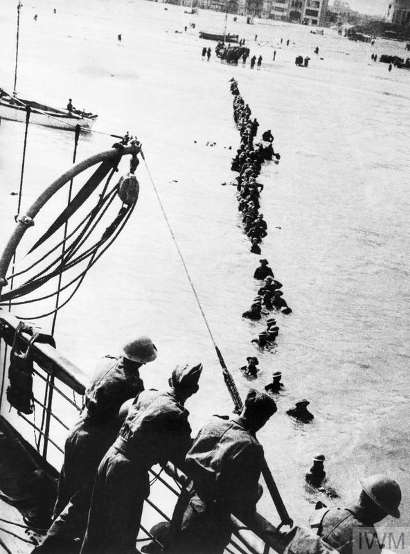 British soldiers wade out to a waiting destroyer off Dunkirk during Operation Dynamo.