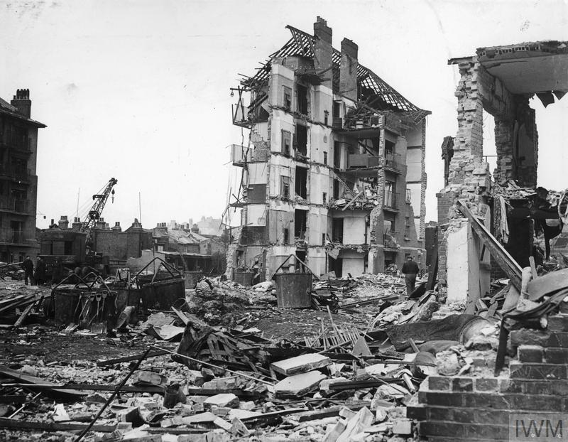 Ruined flats in Limehouse, East London. Hughes Mansions, Vallance Road, following the explosion of the last German V2 rocket to fall on London, 27 March 1945.