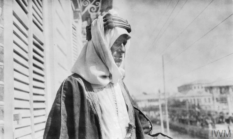 Colonel T E Lawrence on the balcony of the Victoria Hotel in Damascus on 3 October 1918, half an hour after he had resigned his position in the Arab Army.