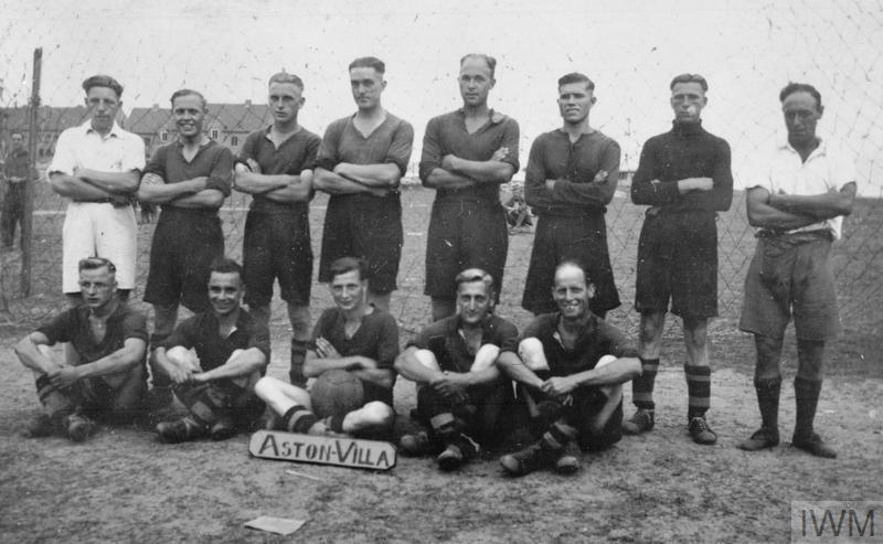 "Group photograph of the ""Aston Villa"" football team, made of British POWs, at the Stalag XXID, Poznań (Posen). The name of the team would imply those soldiers came from the Birmingham area."