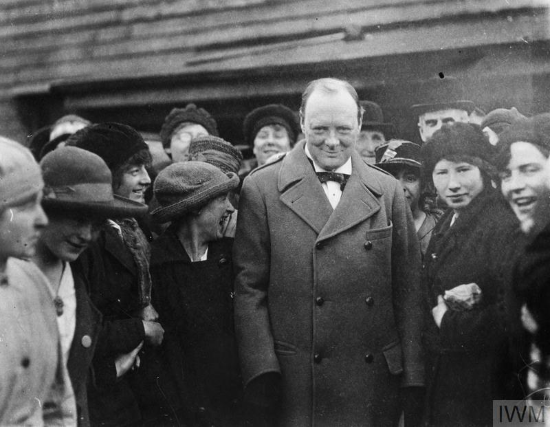 The Minister of Munitions Winston Churchill meets female workers at Georgetown's filling works near Glasgow during a visit on 9 October 1918.
