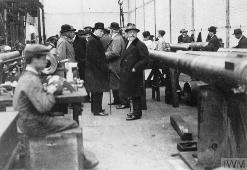 The Minister of Munitions Winston Churchill inspects a production line for heavy guns during a visit to Beardmore's Munitions Works in Glasgow on 8 October 1918.