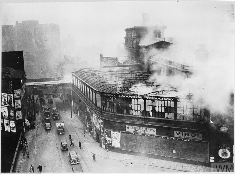 A building on fire in Manchester after a German air raid.