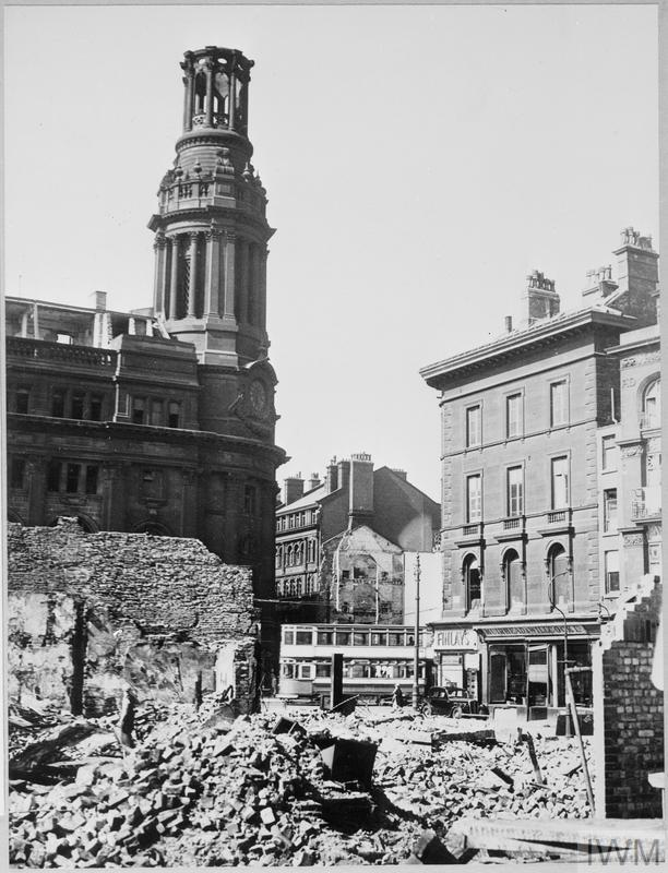 Bomb damage in central Manchester. The Royal Exchange (on the left) suffered a direct hit in the December air raids.