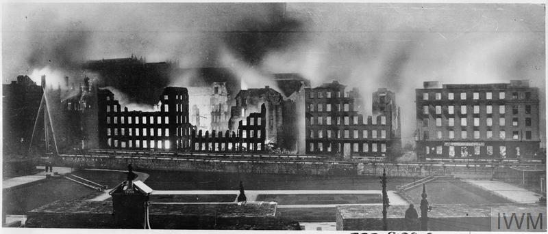 Buidings in Manchester Picadilly on fire after German air raids.