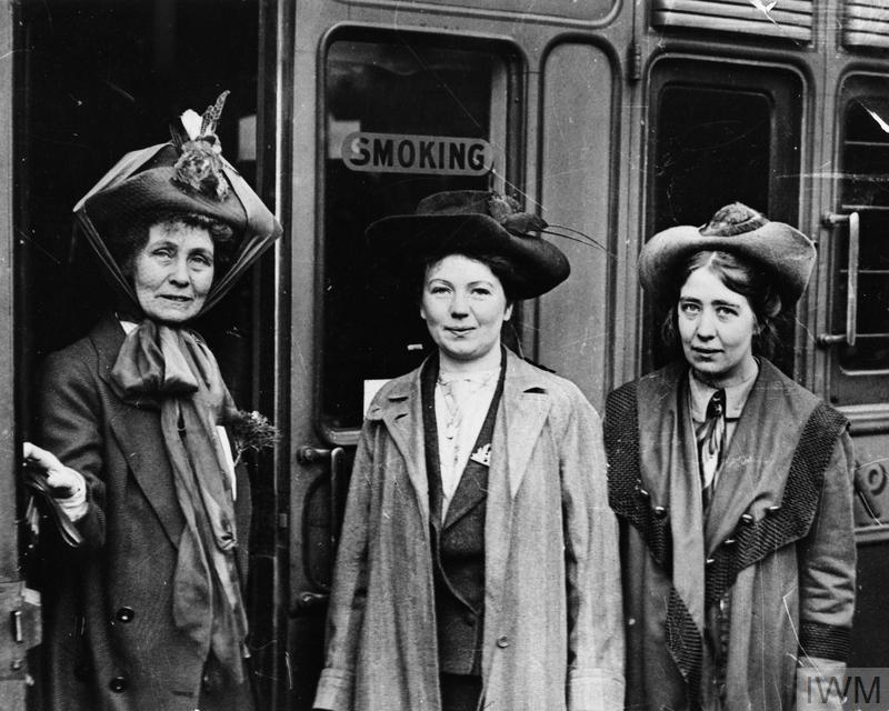 A portrait of the leader of the Women's Suffragette movement, Mrs Emmeline Pankhurst (left) and her daughters Christabel (centre) and Sylvia (right) at Waterloo Station, London. Mrs Pankhurst was about to leave for a lecture tour of the USA and Canada.