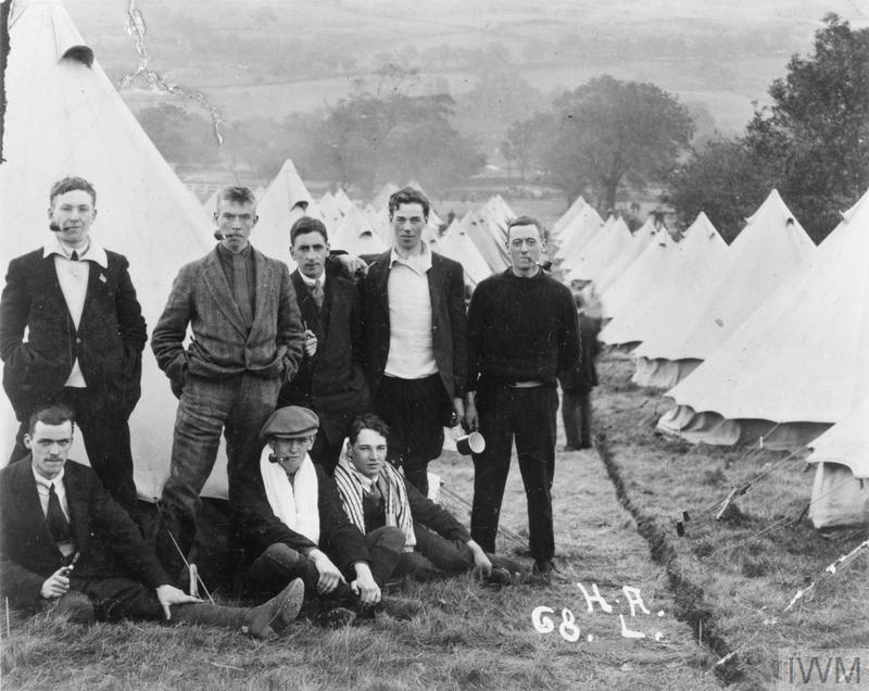 A group of 'Leeds Pals' photographed at their training camp in the Yorkshire Dales shortly after enlisting on the outbreak of the First World War. Albert Knowles is on the right (pipe in mouth). A local benefactor gave the pipes, but the unifoms did not arrive until November.