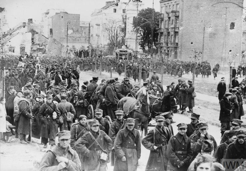 Polish soldiers marching out of the Warsaw garrison after it is taken by Germans on 28 September 1939.