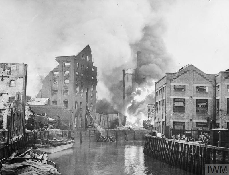 British Oil and Cake Mills on fire at Hull Docks after an air raid.