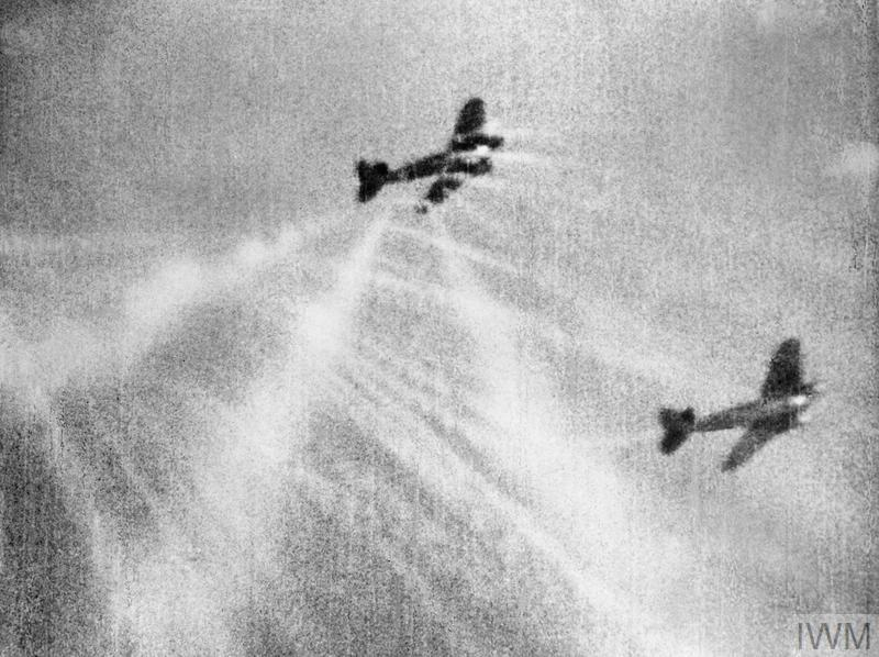 A still from camera gun film shows tracer ammunition from a Supermarine Spitfire Mark I of No. 609 Squadron RAF, flown by Flight Lieutenant J H G McArthur, hitting a Heinkel He 111 on its starboard quarter. These aircraft were part of a large formation from KG 53 and KG 55 which attacked the Bristol Aeroplane Company's works at Filton, Bristol, just before midday on 25 September 1940.