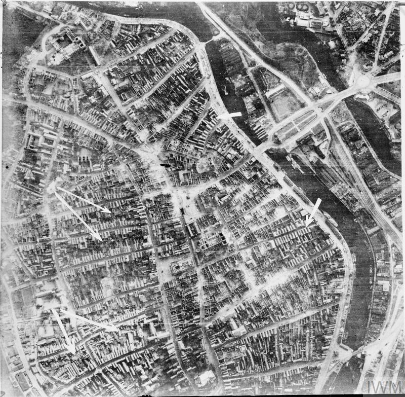 Vertical photographic-reconnaissance photograph taken over Lubeck, Germany following the major night raid by Bomber Command aircraft on 28/29 March 1942. This shows the devastated western part of the Altstadt from the gutted cathedral (top left) to the Drehbrucke (bottom right) and Kanalstrasse (bottom left).
