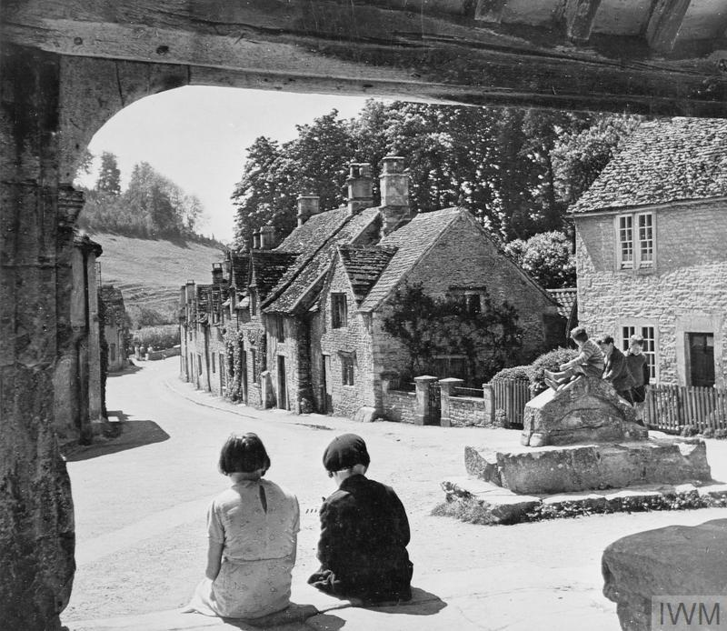 Children play in the street of a village somewhere in England after being evacuated from London.