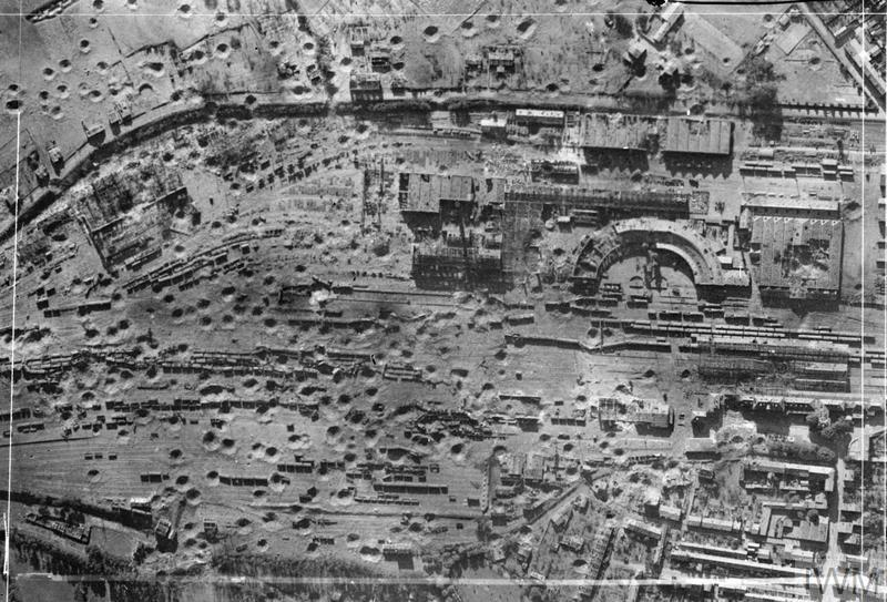 © IWM (C 4438) Vertical photographic-reconnaissance aerial taken over the railway yards at Saintes, France, following an attack by aircraft of Bomber Command on the night of 23/24 June 1944.