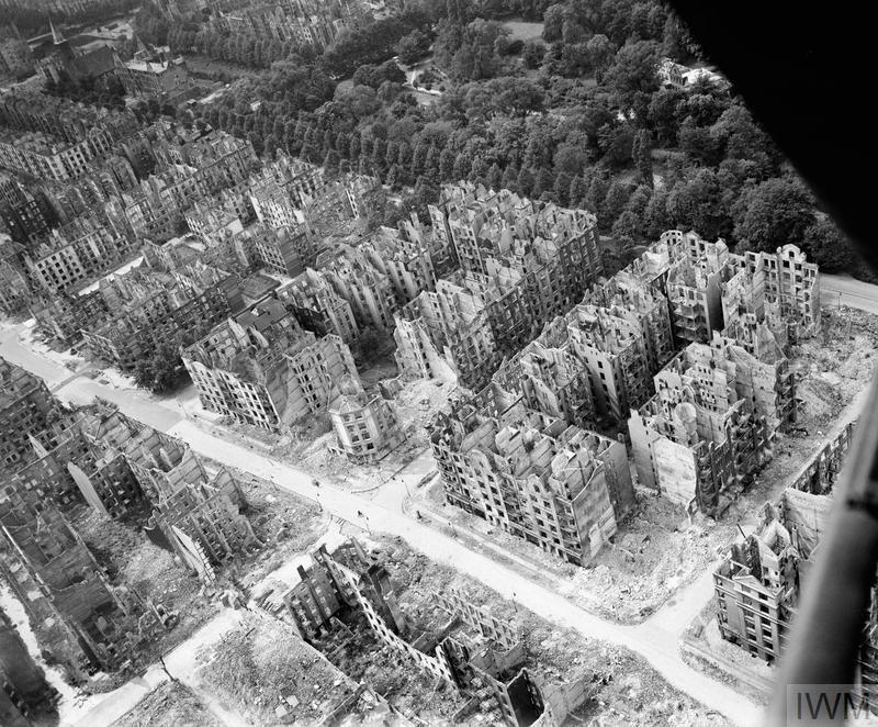 Oblique aerial view of ruined residential and commercial buildings south of the Stadtpark (seen at upper right) in the Eilbek district of Hamburg, Germany. These were among the 16,000 multi-storeyed apartment buildings destroyed by the firestorm which developed during the raid by Bomber Command on the night of 27/28 July 1943 (Operation GOMORRAH). The road running diagonally from upper left to lower right is Eilbeker Weg.
