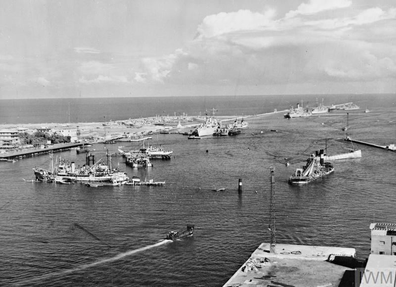 General view of the Suez Canal at Port Said showing a number of the blockships sunk by the Egyptians to prevent used of the canal and Royal Navy salvage vessels preparing to clear these obstructions.