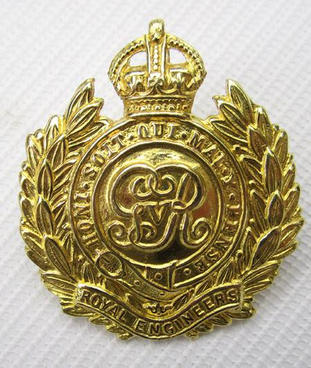 R E Cap badge