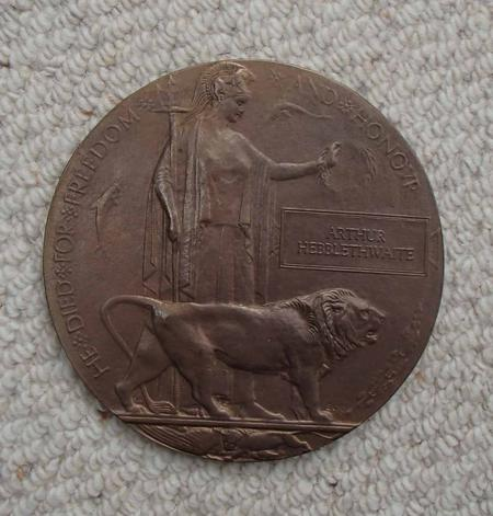 Bronze disc relating to Arthur Hebblethwaite.