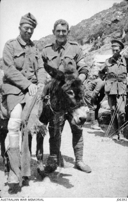 John Simpson (centre) assisting a wounded soldier