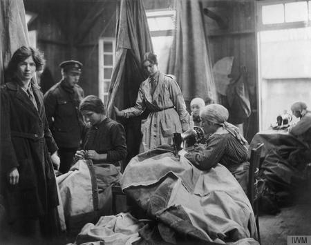 French civilian women repairing tents