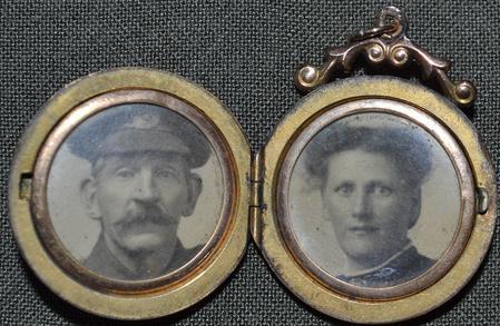Locket containing photographs