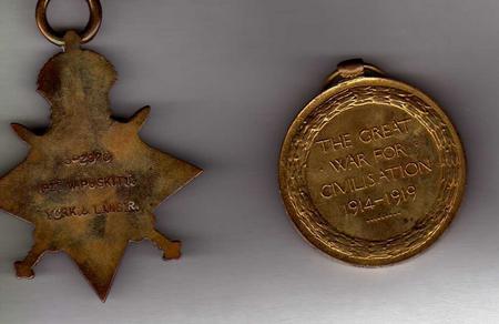 Backs of William Poskitt's medals