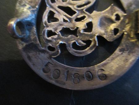 The reverse of Benjamin Brettle's Silver Badge