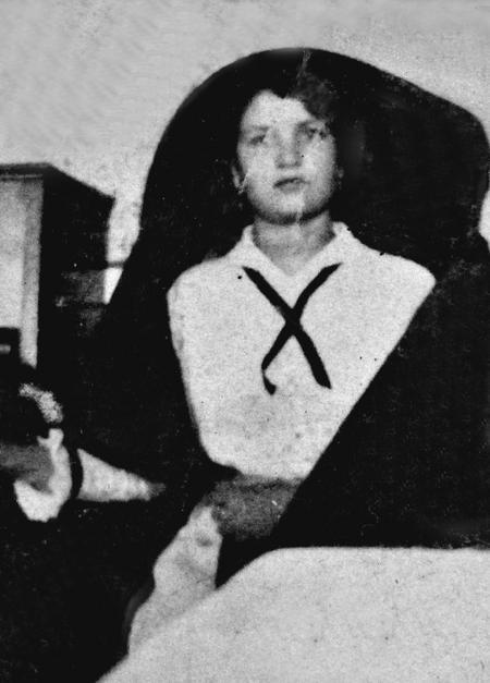 Young woman wearing a faldetta, Malta, 1916