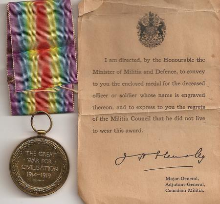 Victory Medal and accompanying note.