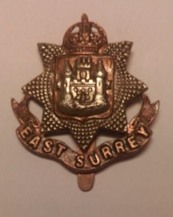 The cap badge of the East Surrey Regiment