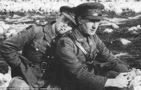 Glover in uniform on left