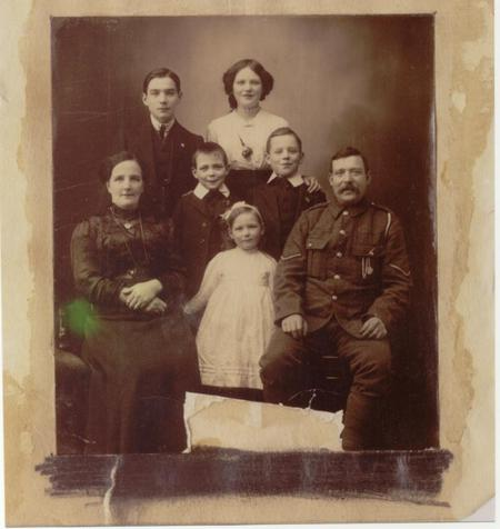 Tom Holmes in his army uniform with his family