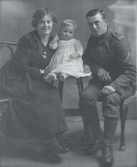 Charles Newcombe with his wife and daughter.