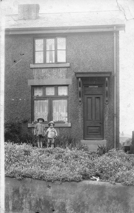 Leonard's youngest children outside their home