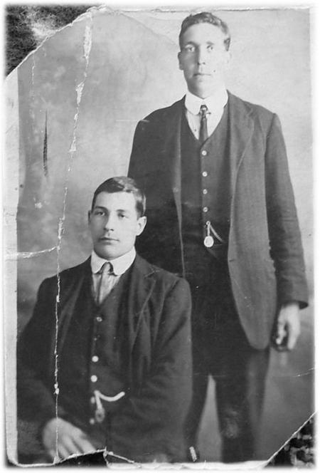 Thomas (standing) and his brother Jack