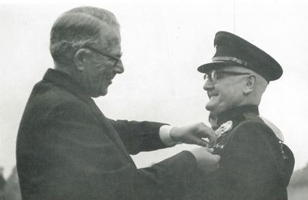 Harold Corble receiving the BEM