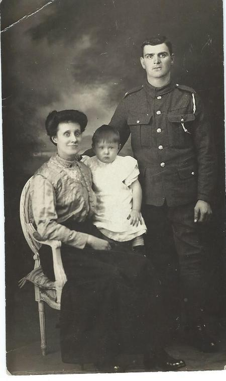 James Barker with his wife, Elizabeth, and son