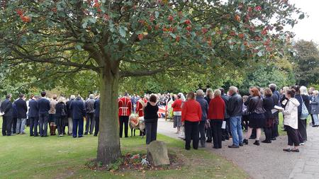 Group paying respects at the unveiling