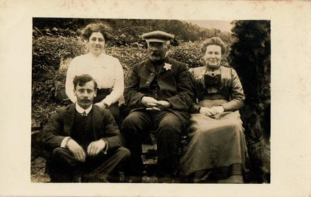 George with his parents and sister circa 1913