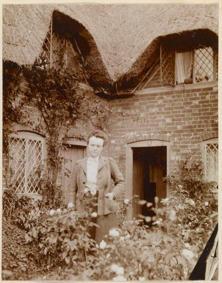 Photograph of Sarah outside a cottage