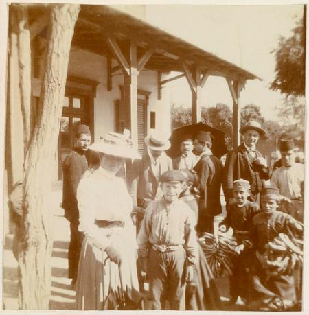 Photograph of Sarah with men and children