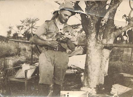 Barry Galbraith in Africa holding small animal